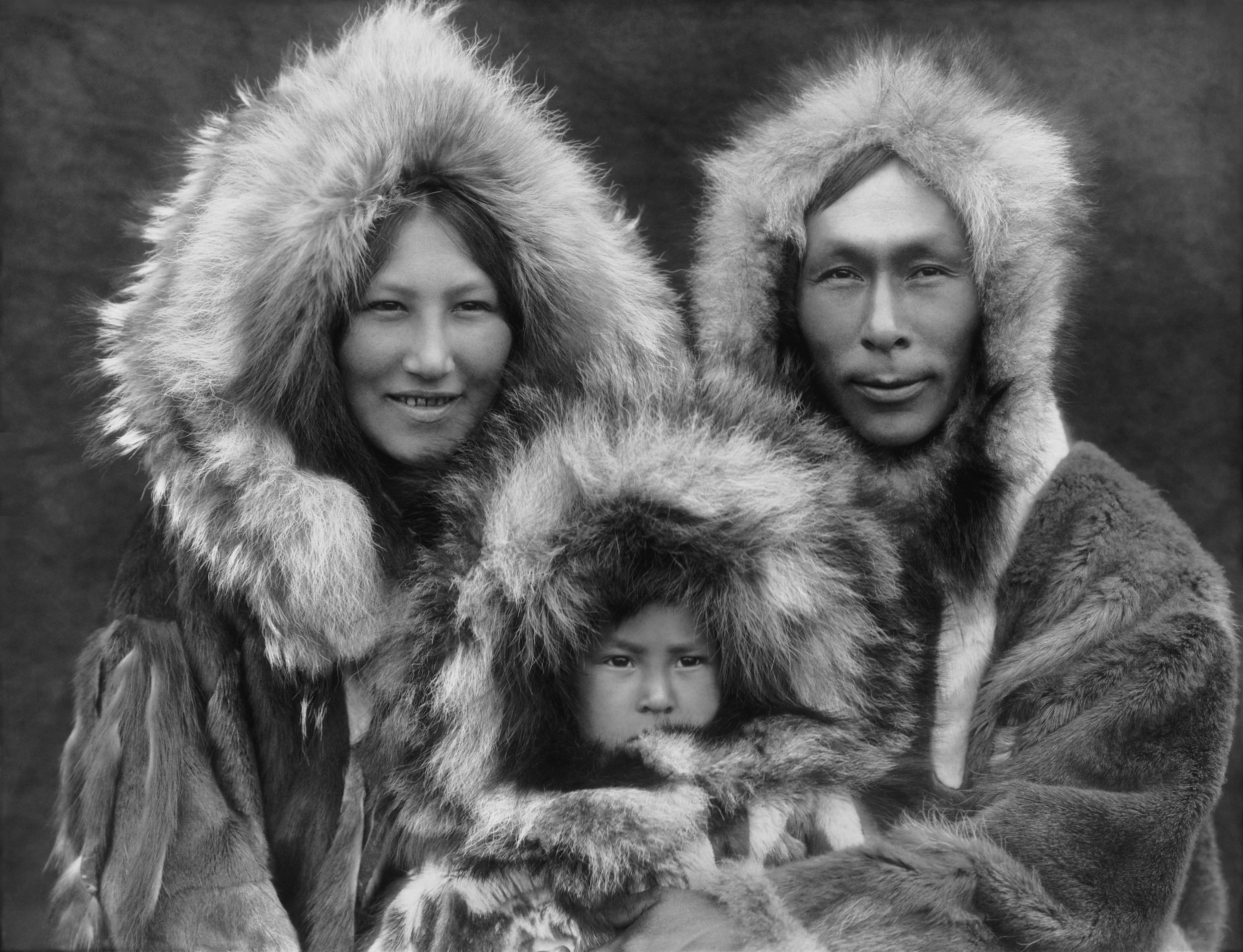 A family photo of an Inupiat Eskimo mother, father, and son, photographed in Noatak, Alaska, by Edward Sheriff Curtis circa 1929. The scan was made from a black and white film copy negative.